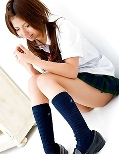 Sasha Japan chick shows pussy in panty under uniform short skirt