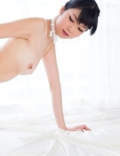 Stockings-wearing seductress Anna Matsuda gets fingered hardcore on a big bed