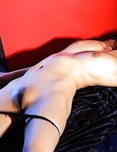 Wakana Kinoshita is undressing her sexy leather panties