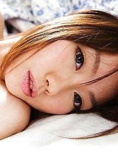 Barely legal Japanese Ichika Sena is slowly undressing
