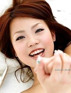 Nana Miyashita is smiling and undressing on the camera