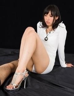 Beauty in white Natsuki Yokoyama giving a sensational footjob on camera
