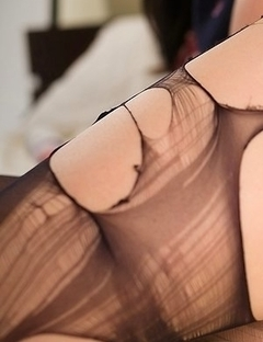 Reo Saionji throws her leg up before using a vibrator thru the pantyhose