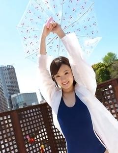 Kana Yuuki in bathsuit plays with umbrella in the balcony